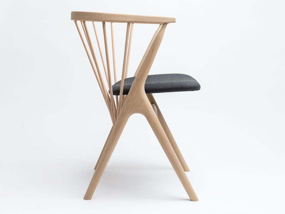 The Sibast No. 8 chair, in solid oak, designed in 1953 by Danish designer Helge Sibast, has been reissued by Sibast's grandson and his wife, Ditlev and Anna Sibast.