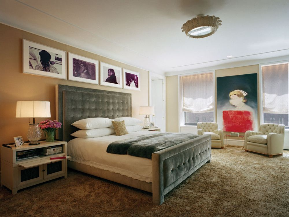 A custom bed anchors a master bedroom that serves as a gallery for Richard Prince works. Above, the clients' own white plaster acanthus ceiling fixture.