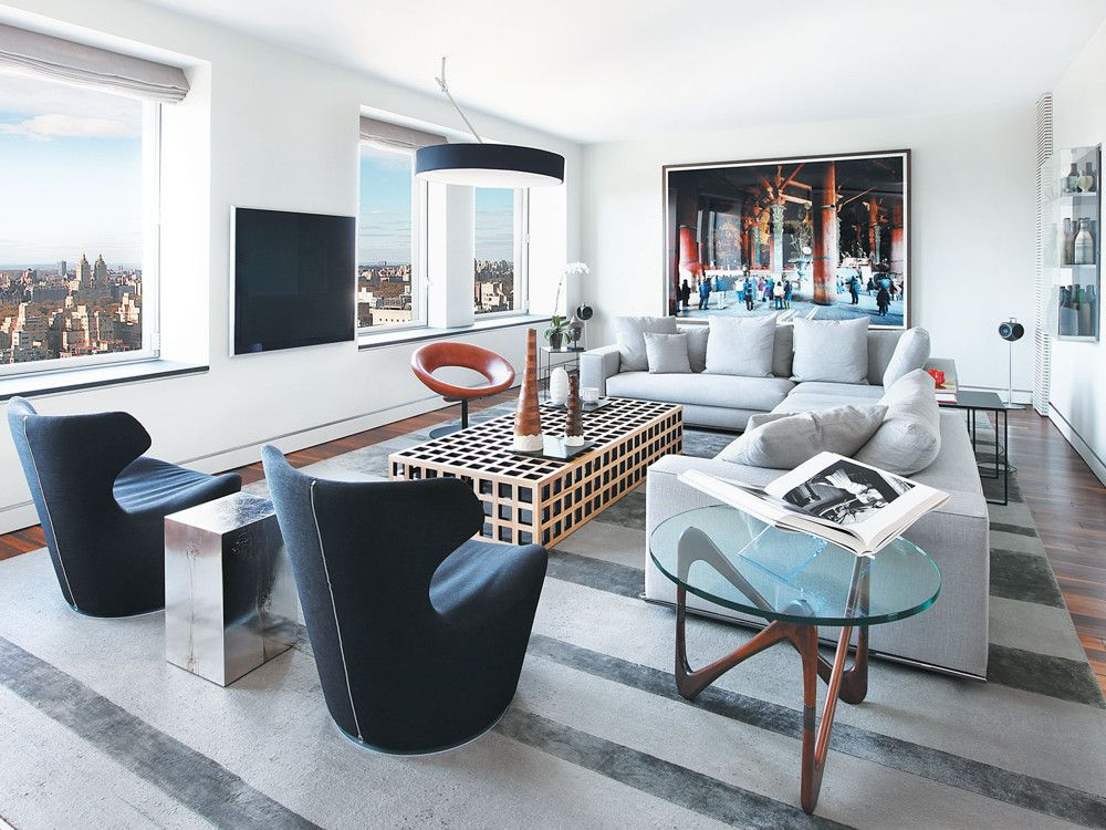 In this art-filled apartment, the views are spectacular from every angle. With the Hamilton sofa by Minotti and DWR's Noguchi side table, a living room seating area faces the cityscape.