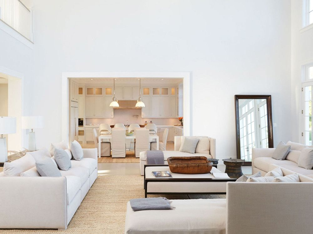 At 249 Jobs Lane in Bridgehampton – one of the most desired streets in the Hamptons – walls of glass and nine foot doors create natural warmth. Courtesy of Bespokerealestate.com