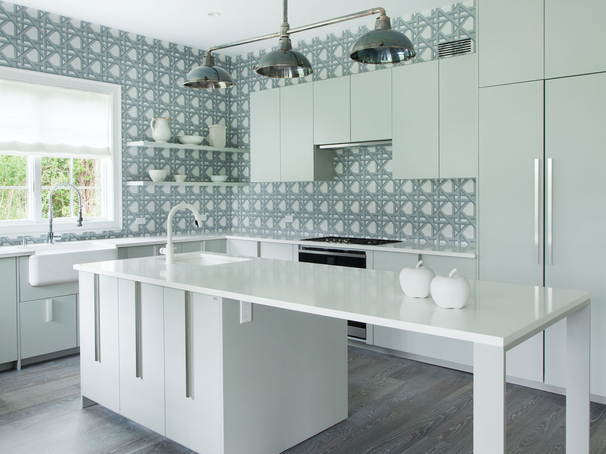 The kitchen cabinetry is by Effeti with white Caesarstone countertops, tiles on the back wall were designed by Gentet for Imagine Tile.