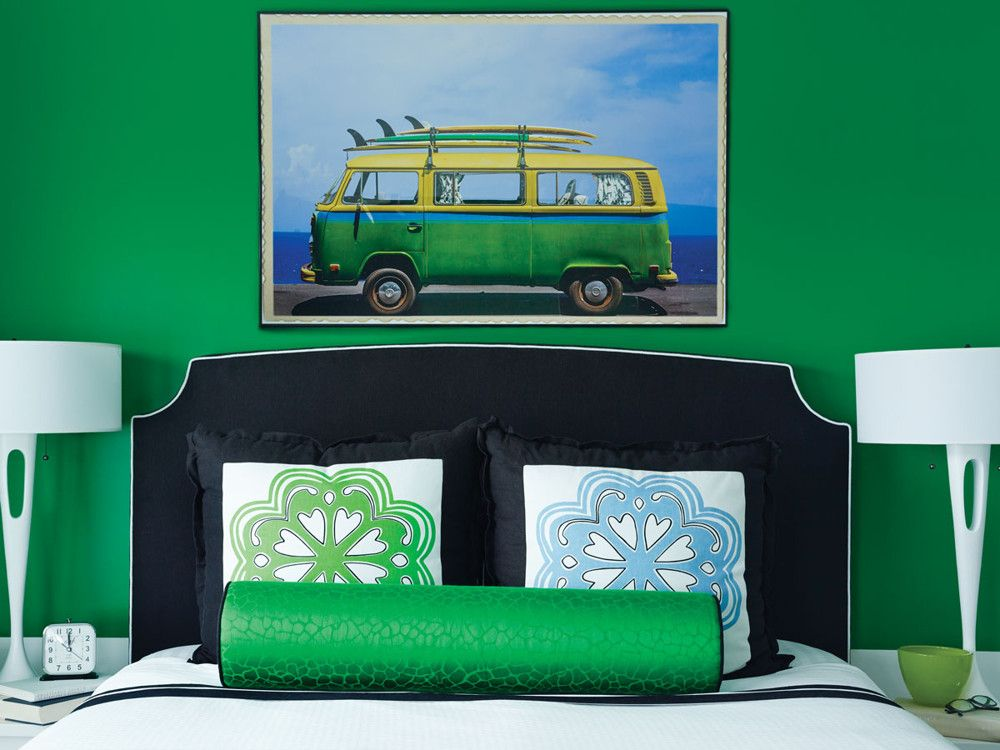 The middle daughter's emerald green room features a custom headboard and playful artwork.