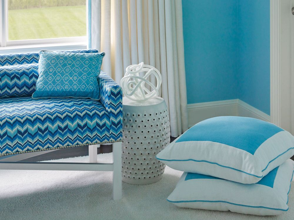Fabric by Jonathan Adler covers the custom bench and windows in the youngest daughter's room.