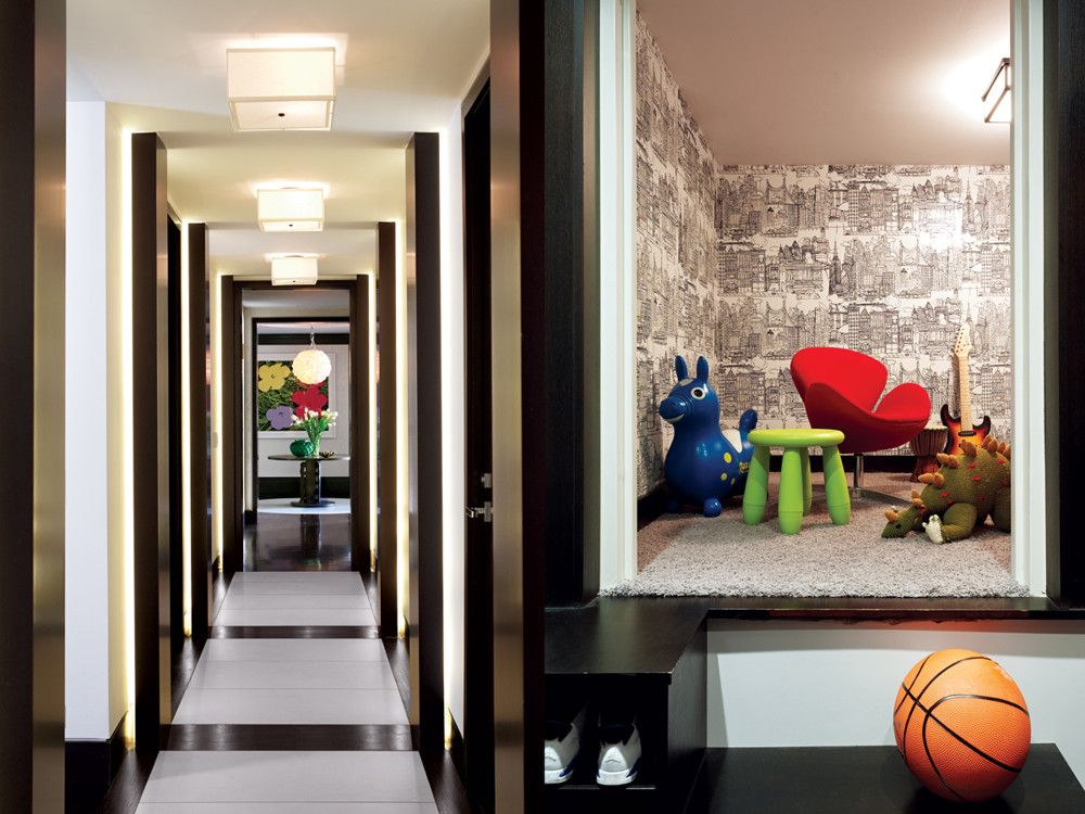 Left: A rock crystal orb chandelier and a Warhol mark the entryway at the end of the hall. Right: Off one of the children's bedrooms, in a closet, was a small, approximately 4-foot-tall room that the owners gave up for storage to transform it into a play space. The walls were papered in Lee Jofa's Cityscapes, a Jacobsen egg chair was added, and various fun toys were brought. Voila: A secret fort was born.