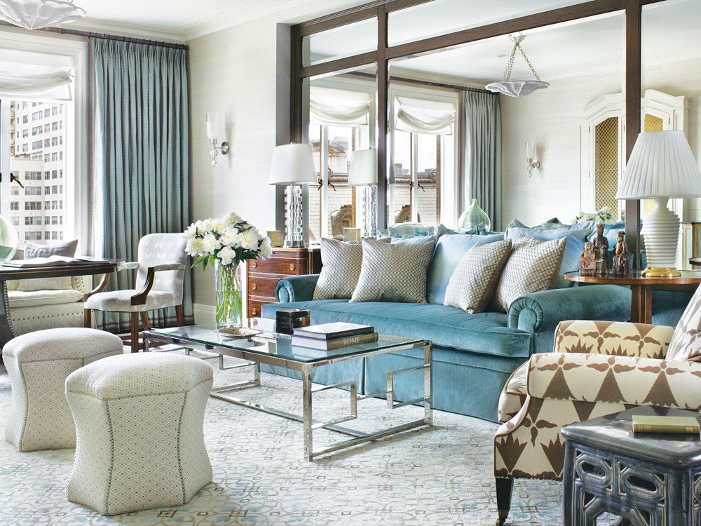 The sofa is a treasured remnant from the Gaudios' old apartment. The graphic pattern on the Edward Ferrell chair balances the right side of the room.