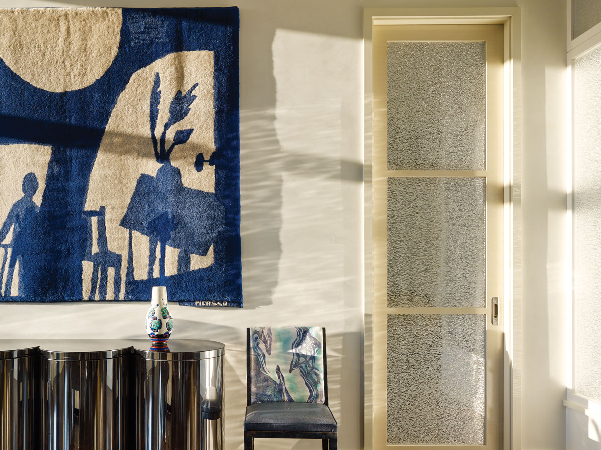 The inspiration for the Braxton fabric came from a Picasso tapestry acquired from Wright Auctions in Chicago, which hangs above a chrome Paul Evans console from the 1970s.