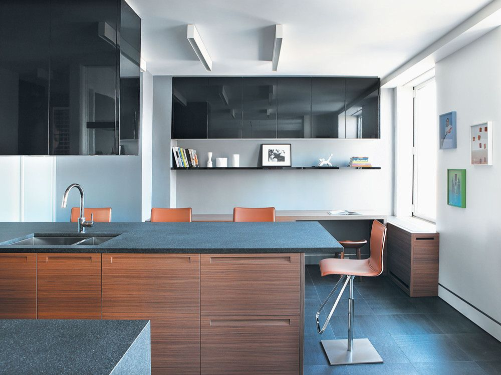 Form follows function in this luxuriously spare, quietly elegant, and very hardworking family kitchen. Cabinets by Poliform define the central island, and provide storage throughout the multi-function kitchen interior. Toto leather-covered stools from Eurofurniture offer convenient perches for chatting while preparing meals.