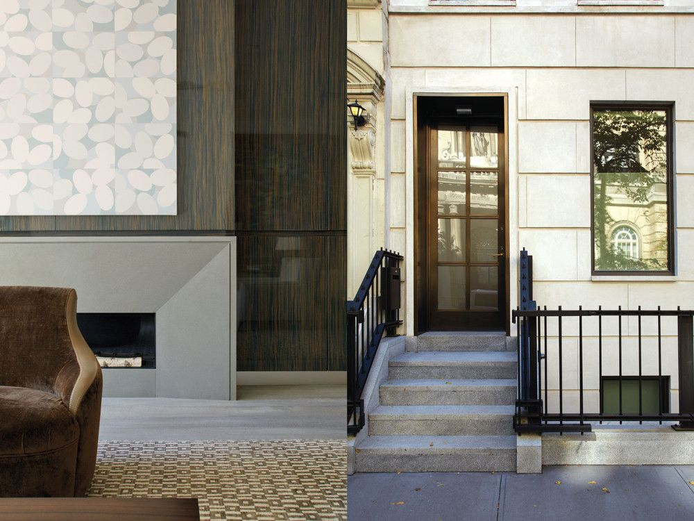 Left: On the opposite wall is a French gray limestone fireplace enveloped by bleached, clear-lacquered Macassar ebony paneling. Right: The neoclassical edifice exudes Upper East Side demeanor.