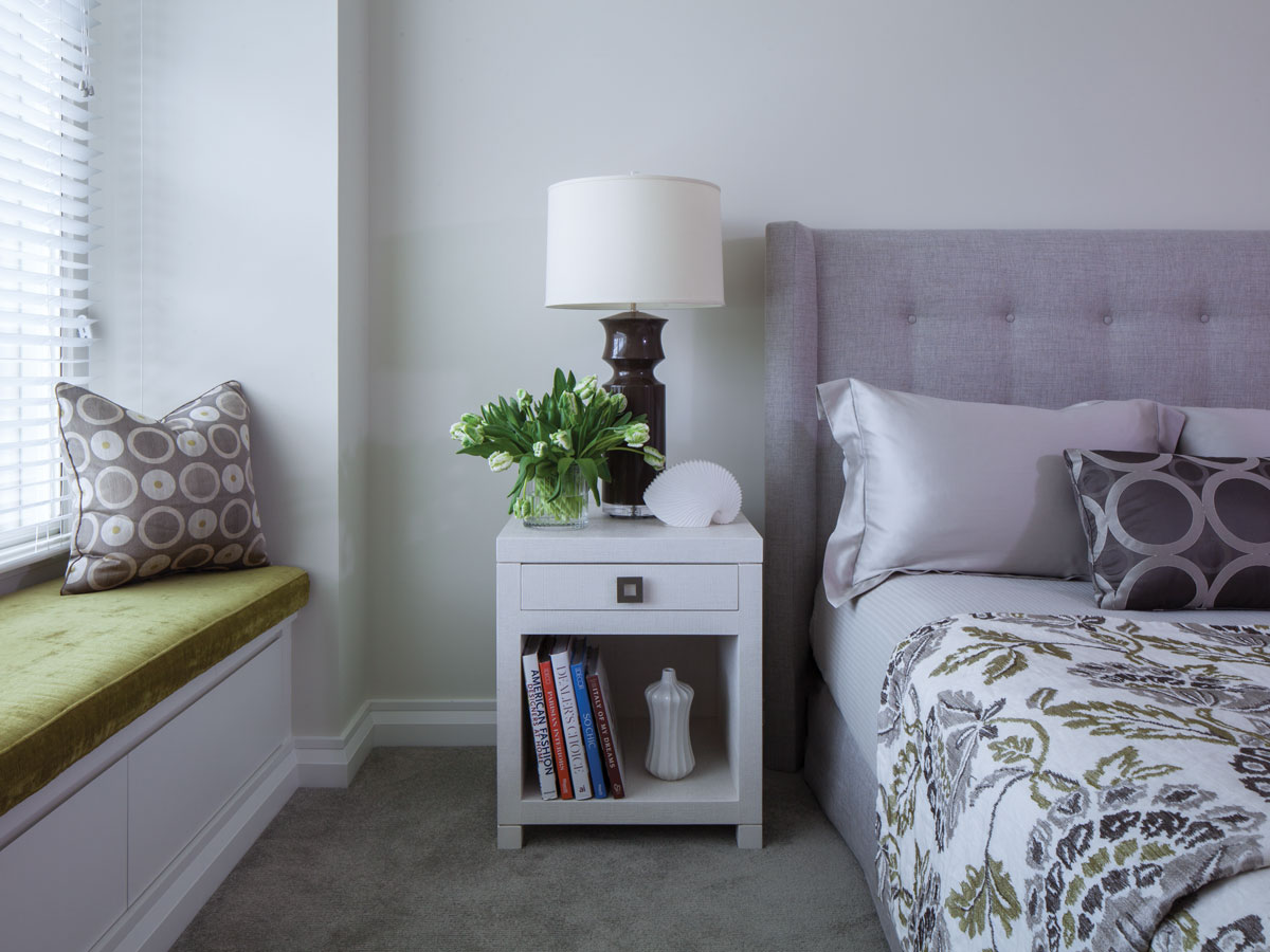 The guest bedroom continues the lilac theme with an added pop of lime green on the window seat. Night stand and headboard custom by White Webb.