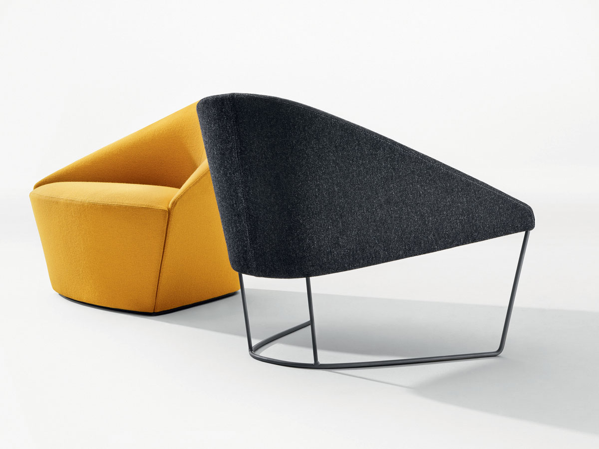 The curvaceous Colina M chair comes in a full range of color options, and customers can opt for fully upholstered, or a version that shows a bit of leg.