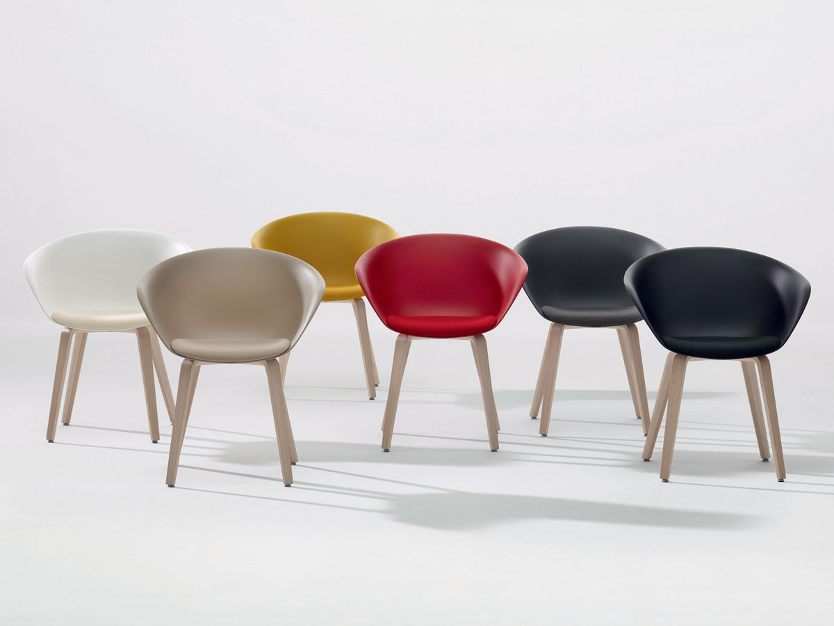 Duna chairs can be upholstered in leather, faux-leather, or fabric, and come in a cantilevered leg option as well.