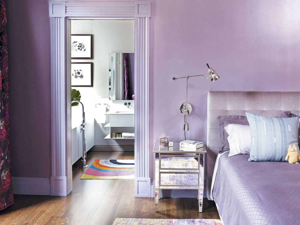 Silver and lavender tones make for a serene palette in the master bedroom suite. The Park Mirrored Bedside table from Pottery Barn reflects the abstract pattern of the rug from ABC Carpet & Home. The bed is a custom design from Avery Boardman. In the master bath, a Kohler Tea-for-Two, Corian-enclosed tub provides relief after a long day.
