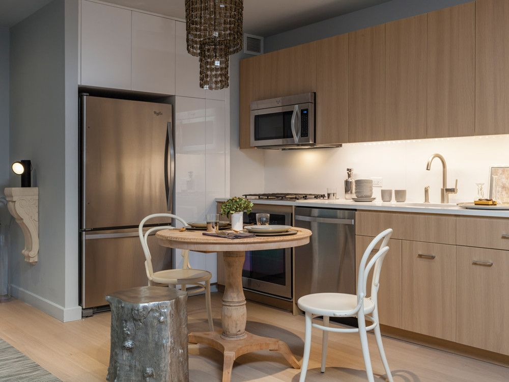 In the smaller, darker apartment's eat-in kitchen, Noriega-Ortiz used the silvered trunk stool to inject an idealized touch of the outdoors into the interior; the stool and Thonet chairs are from ABC Home.