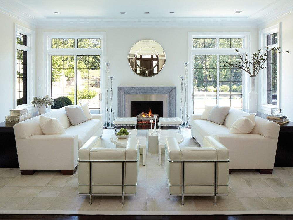 Light, bright, and white, the living room opens harmoniously off the entry hall and flows graciously into the garden. Baldinger paired seating elements in a symmetrical arrangement to create a well-ordered room designed for conversation and comfort. A calfskin rug from Stark sets the stage for facing Jean-Michel Frank-inspired sofas from DeAngelis, each backed by a custom sofa table, and a twin set of Le Corbusier-designed chairs from Cassina.