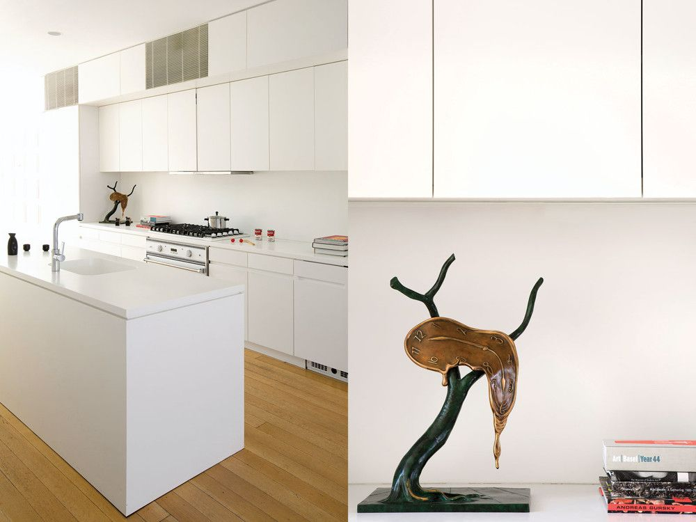 "The Shigeru Ban-designed kitchen; where a counter clock might sit, a bronze sculpture of an iconic Dali image stands instead; a broader view of the kitchen; the collector casting a watchful eye over her domain. ""I was surprised to find myself telling big guns in finance what art to buy,"" Ecer remembers. ""And I was even more surprised that they listened to me."""