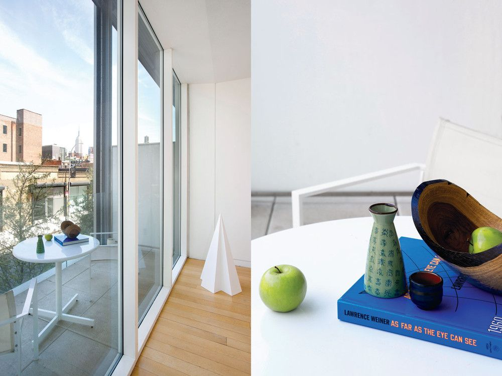 A Sol Lewitt structure stands sentry off the north terrace; on the terrace table, a green apple counterbalances a celadon vase atop a Lawrence Weiner monograph, Pratesi bedding provides a minimalist retreat.