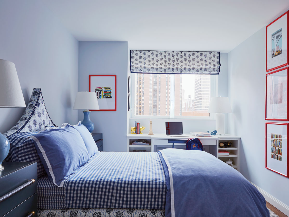 The boy's room in cobalt blue with red accents on the walls.