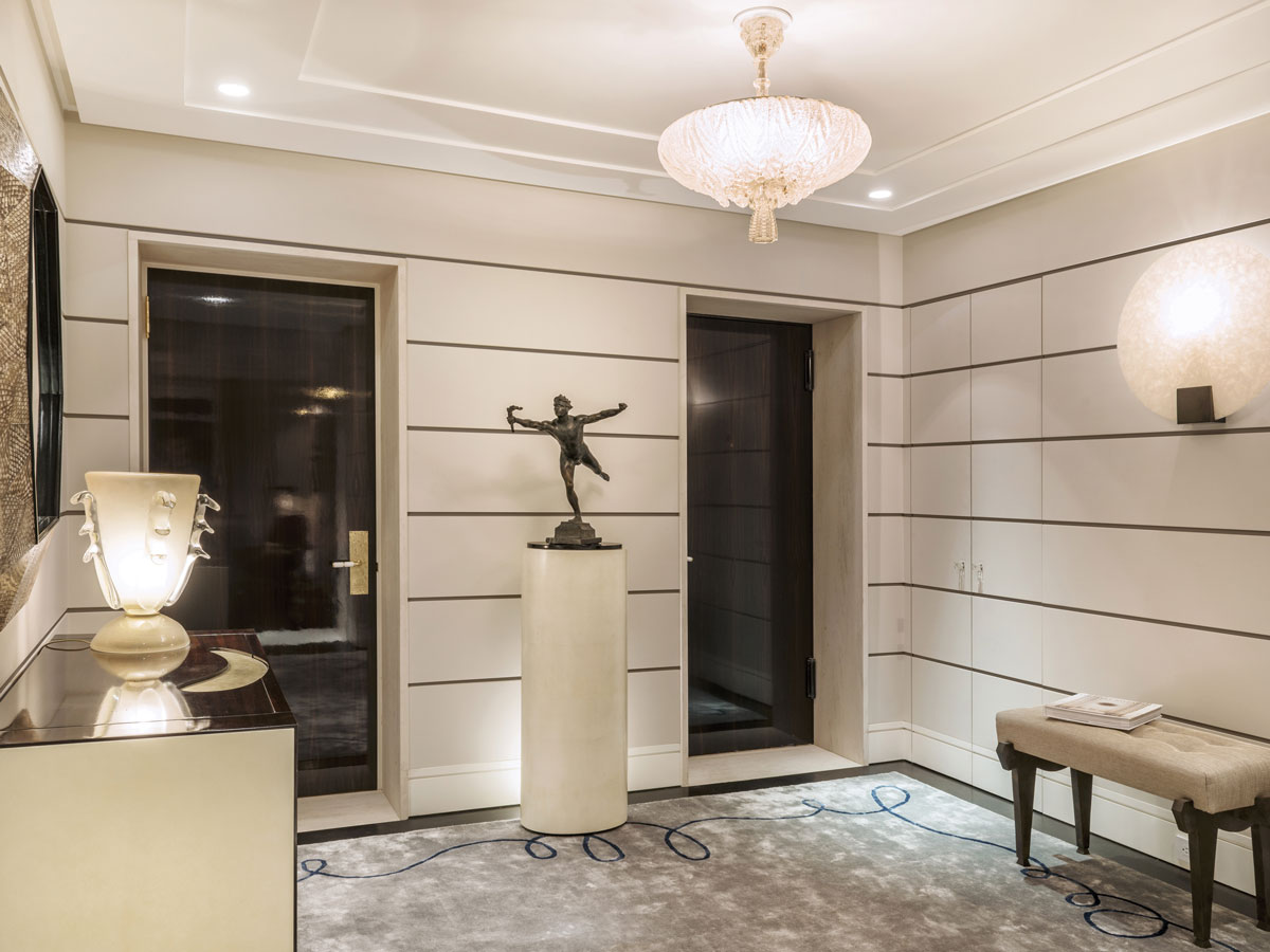 The classical entryway has a modern twist, with the designer's Ovo cabinet and Lucy mirror. The Barovier&Toso chandelier is from 1920.