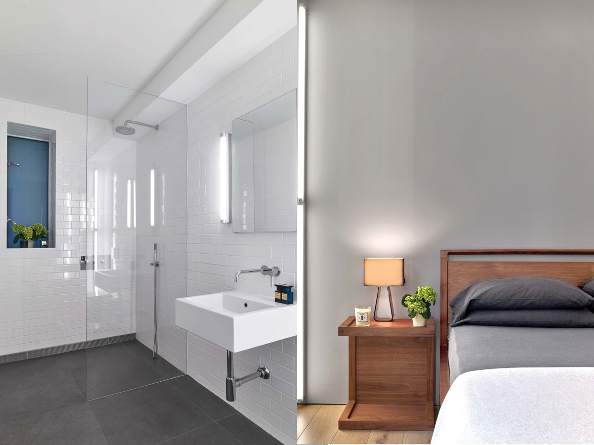 Left: In the original bathroom, the designers replaced the bathtub with a walk-in shower, tiled the walls in 3-inch by 6-inch subway tiles, and the floors in gray Basaltina stone. Right: To add a pop of color to the bedroom, the designers painted the back wall a soft gray that went well with the furniture—all from Design Within Reach—and complemented the floor tile in the en-suite bathroom.