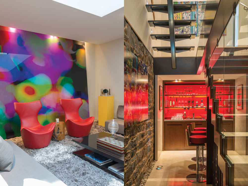 Left: A pair of Papilio chairs stand guard in front of Irene Mamiye's abstract photography panels—C-Prints mounted to aluminum. Right: A panel of back-painted red glass warms the basement bar.
