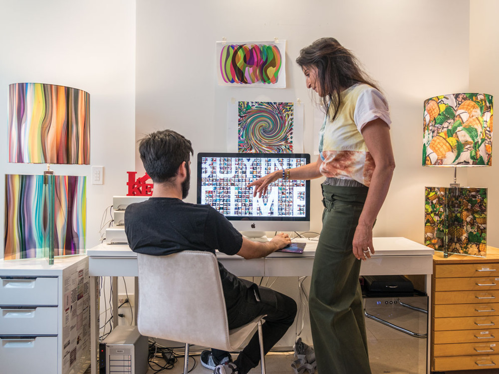 Irene Mamiye and an assistant work in her second floor studio.
