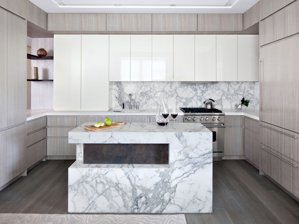 The designers chose polished Calacatta marble for the kitchen island and 