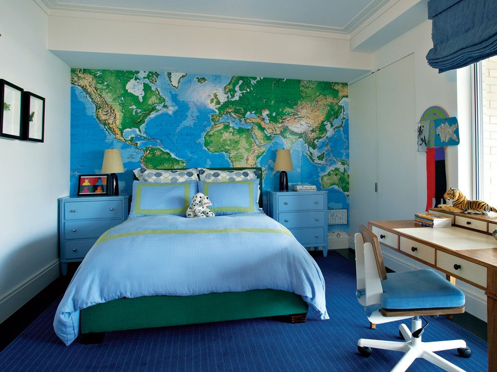 The colors of Hammacher Schlemmer's write-on world map reappear in Aronson's wool rug and the green Clarence House linen-upholstered bed.