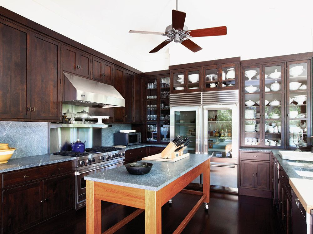 In the kitchen, Fernandez designed all the cabinetry, which accommodates a large collection of creamware, and topped the counters with soapstone.