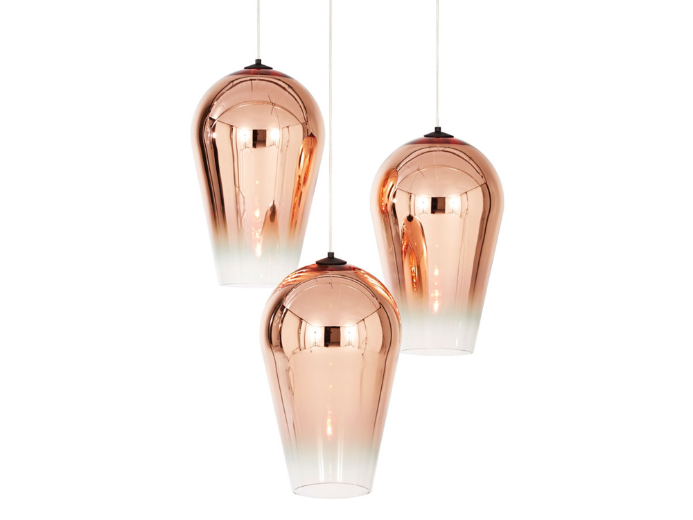 The Fade pendant in copper, from Tom Dixon, is an elegantly simple teardrop shape. The metalized copper finish graduates from reflective to translucent, and casts a perfect circle of warm light.
