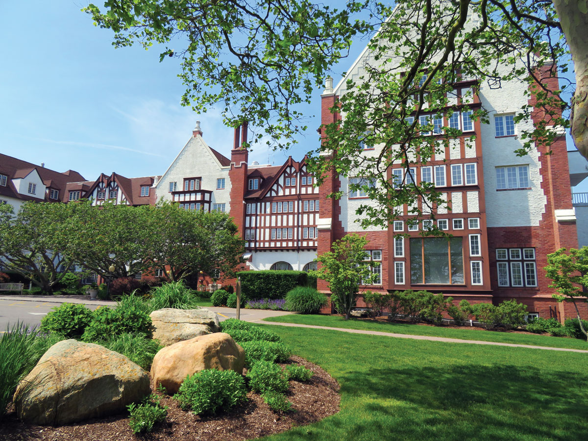 The Montauk Manor hotel, originally built in 1926 in the Tudor Revival style, sits on a hilltop with vistas of the Atlantic Ocean, Gardiner's Bay, and Block Island Sound.