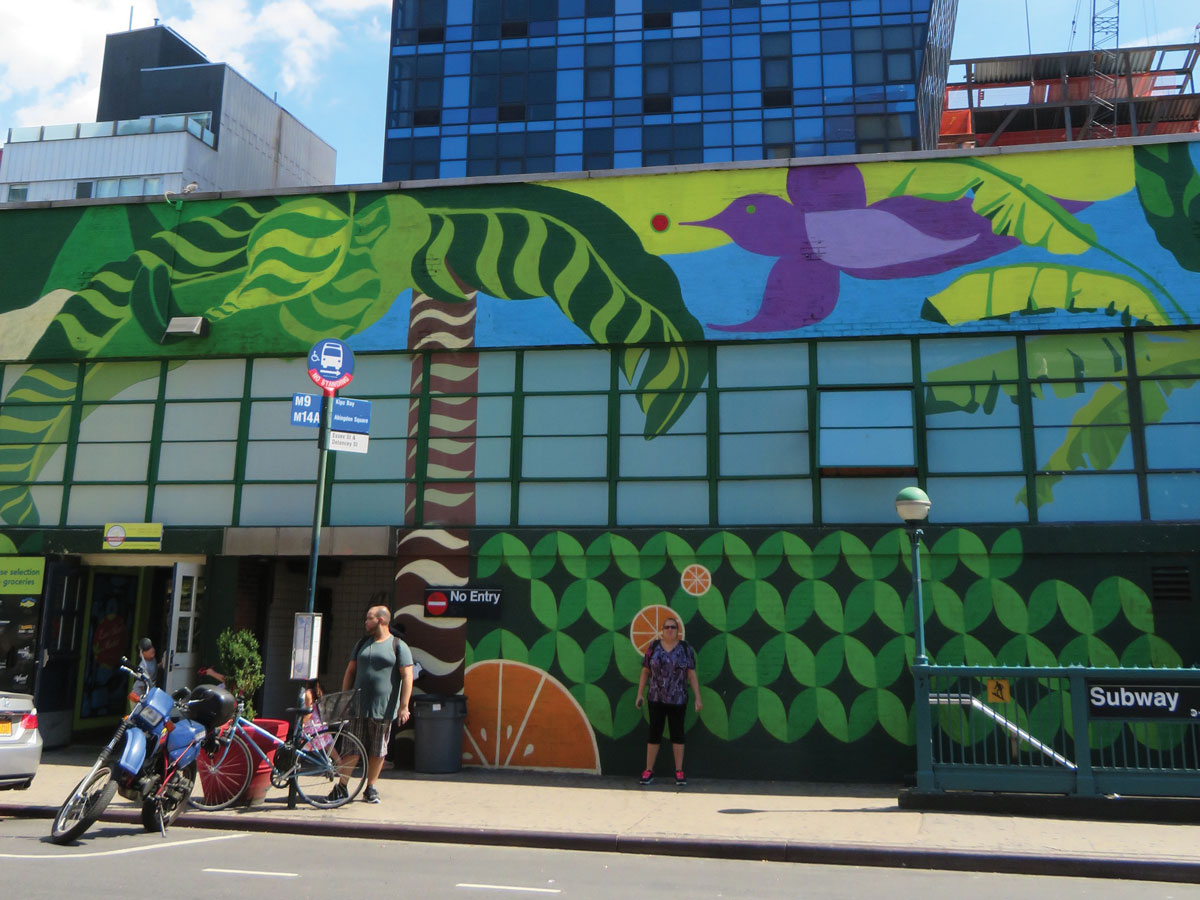 The vibrant and colorful murals on the façade of the Essex Street Market were done by artist Gera Lozano.