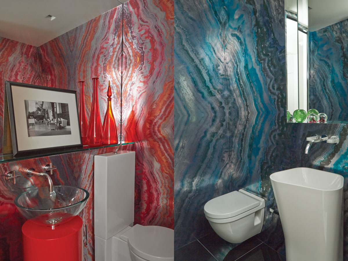 In the bathrooms, wallpaper from Romo mimics brilliantly colored slabs of marble.