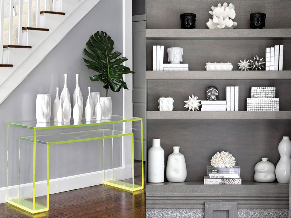 Left: A custom acrylic console by Muñiz Plastics of Miami in the entry accessorized with Global Views ceramics. Right: The room's built-in shelving showcases python-patterned linen from Kravet.