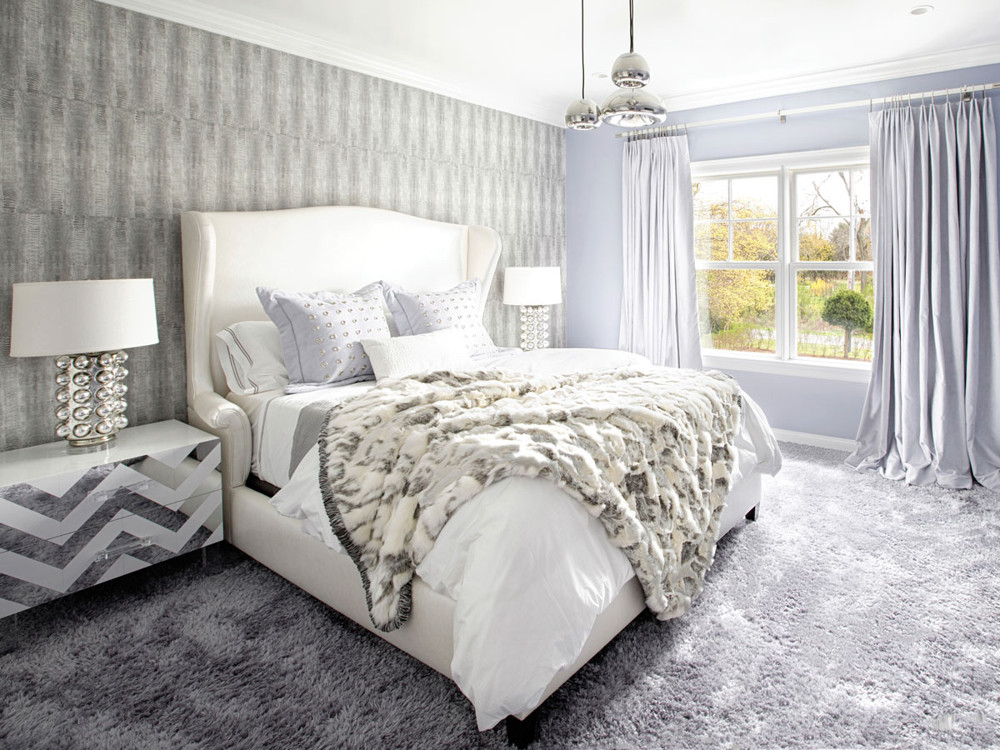 A guest room combines Brett Beldock wallpaper, custom nightstands with etched mirror zigzags, and a Tom Dixon pendant.