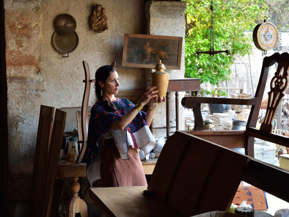 Designer Laura Kirar in an antiques shop in Mexico.