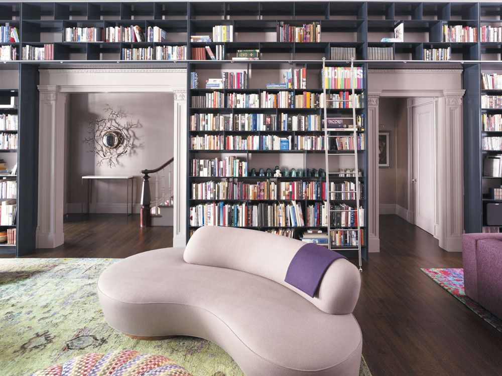There's nothing quite like books to give a room personality; the clients' floor-to-ceiling library also documents their interest in the arts.