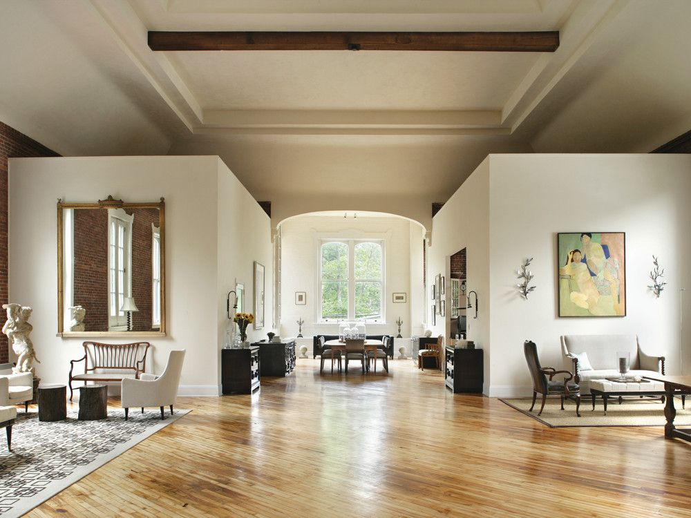 Sitting/living room areas face each other and provide ballast for all the open space.