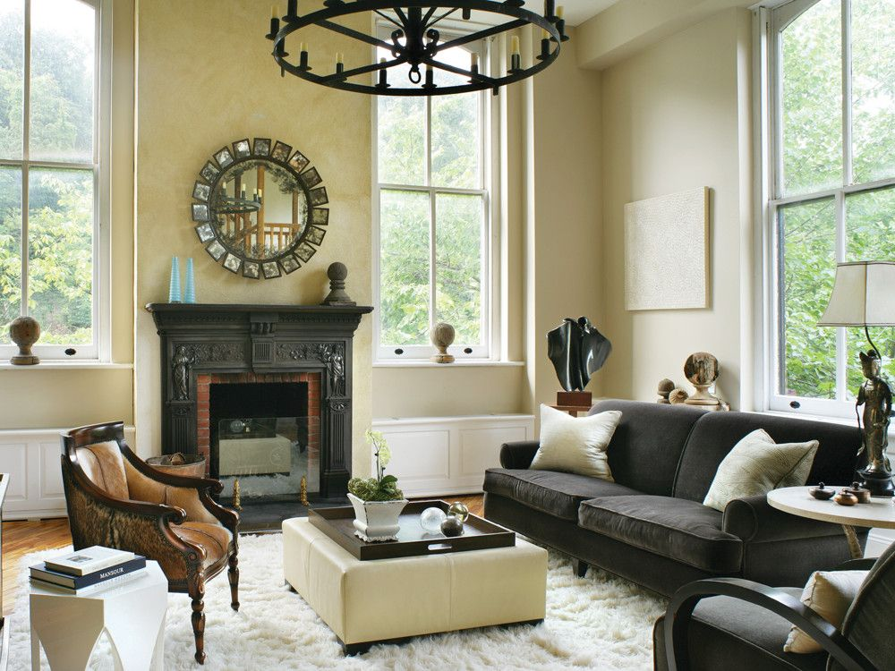 With its wonderful fireplace and distinctive architectural details, the den is one of the apartment's few cozy spaces. Stern emphasized its intimacy with a flokati rug and limestone round side tables; a custom sofa made 