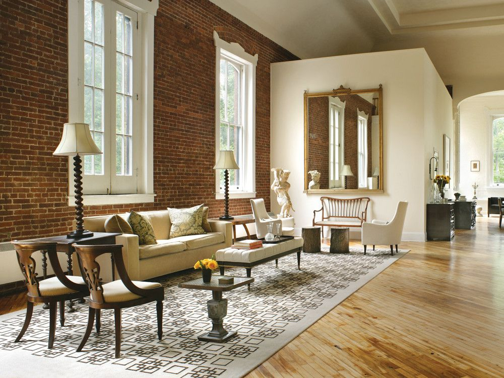 Stern floated a series of sitting/living areas along the apartment's perimeters. Throughout, scale was a significant issue. To establish the floor plate  for this sitting area, she used a 21 ½-ft. by 12 ½-ft. custom wool rug from Seldom Seen Designs in Livingston, NJ. Her 8-ft. by 6-ft. gilded mirror seems made for that wall. Adding form and texture are Regency chairs, Italian upholstered chairs, a bronze side table, angel sculpture, and lamps from Meryl Stern Interiors, as well as an Art Nouveau bench from Sutter Antiques.