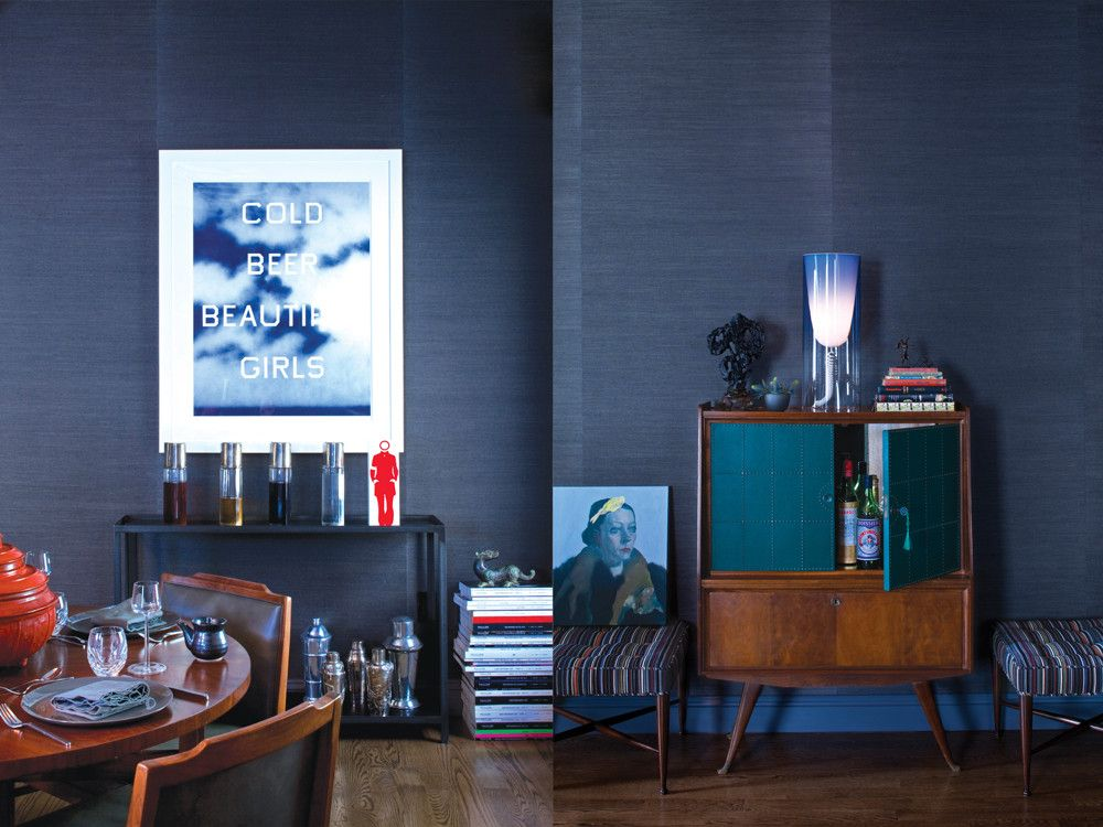 Left: A 2009 lithograph by Ed Ruscha holds court in the living room. Right: A 1960s Italian bar cabinet is enriched by Edward Wormley stools and a Kartell lamp.