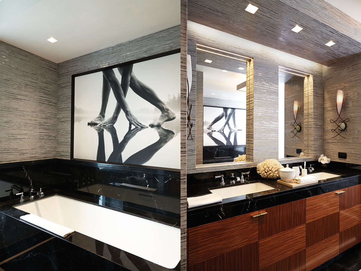 Left: Arno Rafael Minkkinen's photograph hangs above an Absolute Black marble bath against Phillip Jeffries wallpaper Right: Deco-style sconces from Terzani flank the custom vanity made by SilverLining.