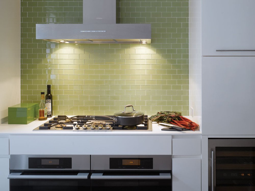 Green Ann Sacks glass tile, Corian counters, and white lacquer cabinetry in the kitchen.