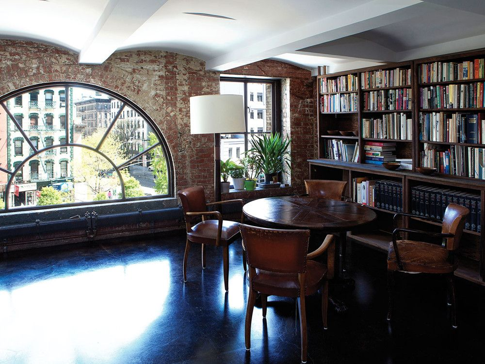 The library centers on an antique wine-tasting table.