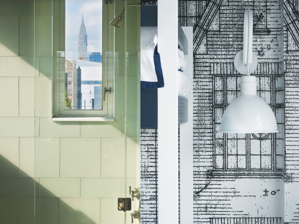 Left: The top-floor bathroom window offers a view of the Chrysler building. Right: Story lined the boy's room with wallpaper made from drawings of the early 20th-century building's original elevations.
