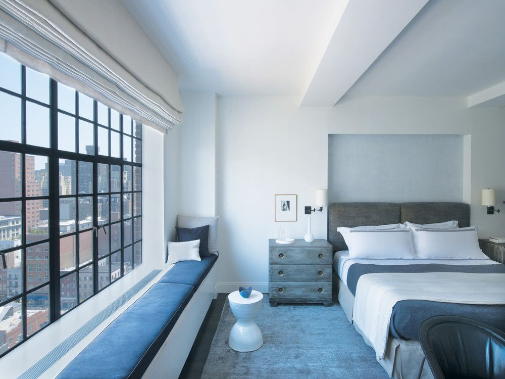 In the master bedroom, done in shades of blue-gray, a cotton-velvet headboard nicely offsets the glossy lacquer walls.