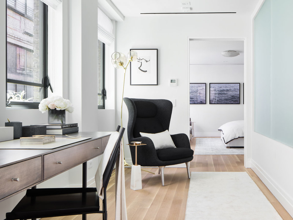 The office provides a transitional area off the center stairway, leading to the master bedroom. The Easy chair by Republic of Fritz Hansen faces a frosted glass panel which allows light to flow from the outdoors into the bedroom.
