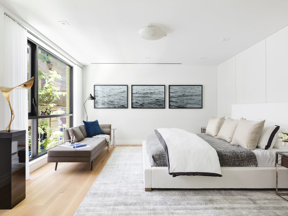 The Master bedroom is a serene escape from the rigors of the day. The platform bed is from Restoration Hardware.