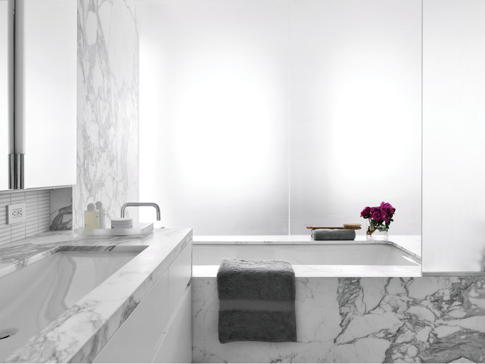 The master bath, clad in marble, has a spa ambiance.