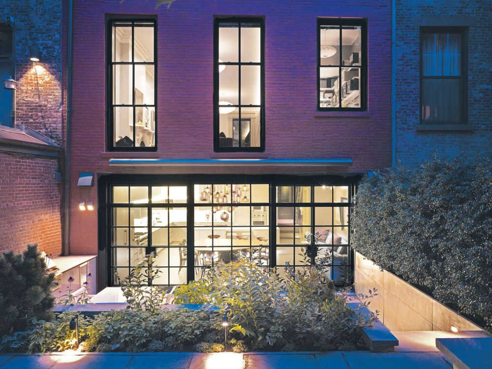 Steel-framed windows offer a glimpse into the art-filled interior of the five-story townhouse.