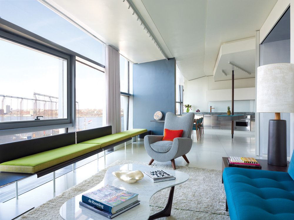 In Situ interacted with the architecture by having the sutures in the rugs line up with the stainless steel bars Nouvel inserted in the terazzo floor. Most of the furniture is built in. A Royere chair and a marble coffee  table are a few of the freestanding pieces.